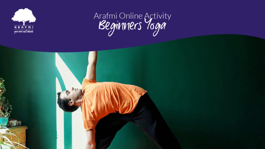 Man doing yoga at home with words Beginners Yoga